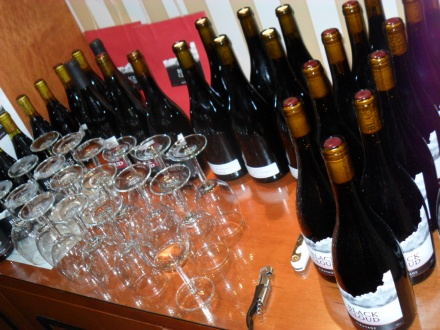 Bottles of Pinot Noir wait to be sampled by participants at the Black Cloud POP-up wine tasting
